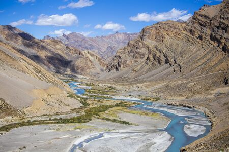 Himalayan mountain landscape along Leh to Manali highway in India. Blue river and majestic rocky mountains in Indian Himalayas, Ladakh, Jammu and Kashmir region, India. Nature and travel concept