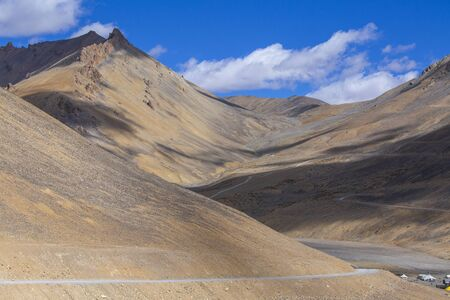 Himalayan mountain landscape along Leh to Manali highway in India. Winding road and majestic rocky mountains in Indian Himalayas, Ladakh, Jammu and Kashmir region, India. Nature and travel concept