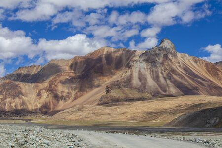 Himalayan mountain landscape along Leh to Manali highway in India. Majestic rocky mountains in Indian Himalayas, Ladakh, Jammu and Kashmir region, India. Nature and travel concept