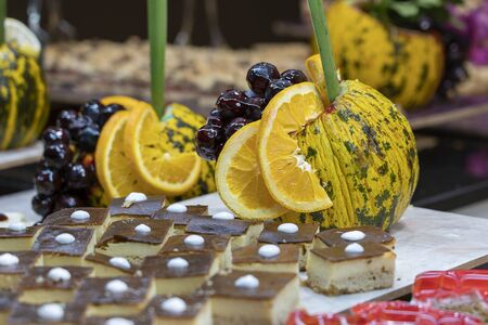Pastries, sweet dessert and decorated fruit in the dining room at the tourist hotel, close up. Turkey Stock Photo