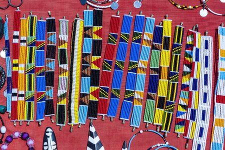 Tribal masai colorful bracelets for sale for tourists at the beach market Reklamní fotografie