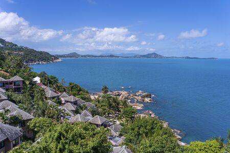 Beautiful scenery at view point of island Koh Samui in Surat Thani Province, Thailand. Travel and nature concept. Sea water, mountains and blue sky with white clouds