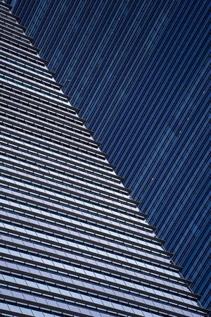 High glass skyscrapers on the streets of Singapore. Office windows background, close up