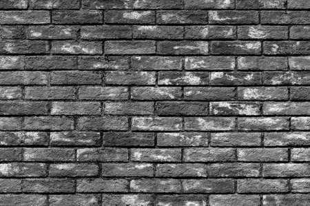 Background of old vintage brick wall texture, black and white
