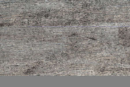 Old gray wooden wall, background and texture, close up. Rustic aged gray wooden board, top view 免版税图像