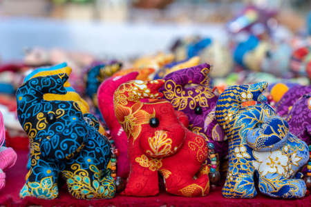 Elephant doll for sell in street market, Thailand. Souvenirs for tourists at market, close up Imagens