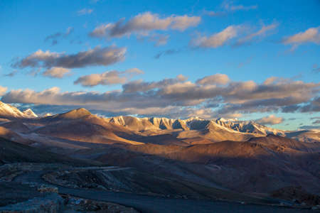 Himalayan mountain landscape along Leh to Manali highway during sunrise in India. Majestic rocky mountains morning in Indian Himalayas, Ladakh, Jammu and Kashmir region, India. Nature, travel concept