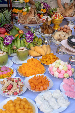 Sacrificial offering food for pray to god and memorial to ancestor, Bangkok, Thailand. Close up. Traditional offerings to gods with food, vegetable and fruit for the gods of Thai culture Stok Fotoğraf