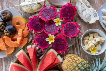 Tropical fruits assortment, close up, top view. Many colorful ripe fruits background. Durian, papaya, watermelon, banana, mangosteen, pineapple and pitahaya or dragon fruit in island Bali, Indonesia Zdjęcie Seryjne