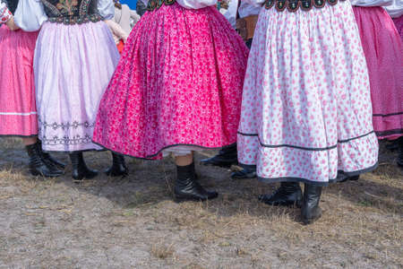 Colorful skirts on at young girls during a festival in Ukraine. Close up