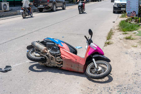 KOH PHANGAN, THAILAND - MAY 19, 2019: Motorcycle accident that happened on the road at tropical island Koh Phangan, Thailand. Traffic accident between a motorcycle on street Sajtókép