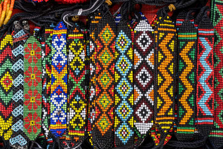 Tribal colorful beads bracelets for sale for tourists at the street market in Kota Kinabalu, island Borneo, Malaysia, close up Stock Photo