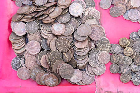 Old, vintage indian coins background in Indian market on the street in Rishikesh, India. Close up.