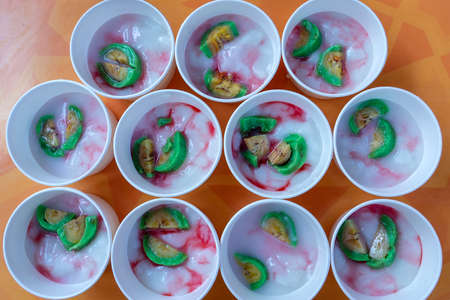 lots of sweet jelly in white cups, close up, top view, Indonesia, delicious asian dessert Imagens