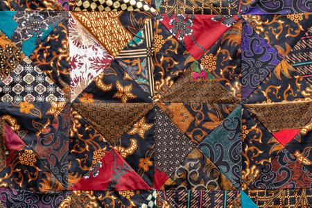 Detail patchwork quilt in street market. Bali island, Ubud, Indonesia. Close up patchwork blanket texture