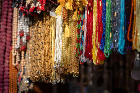 Colorful beads jewelry at the Indian street market, close up. Rishikesh, India