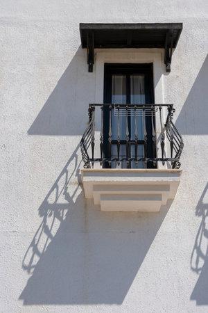 Windows with balcony on building facade with cast iron ornaments in Bodrum, Turkey Foto de archivo