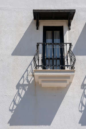 Windows with balcony on building facade with cast iron ornaments in Bodrum, Turkey Banco de Imagens