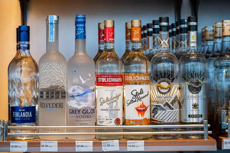 Bodrum, Turkey - September 10, 2019: Bottles of assorted vodka on the shelf in the duty-free shop inside the airport Bodrum, Turkey