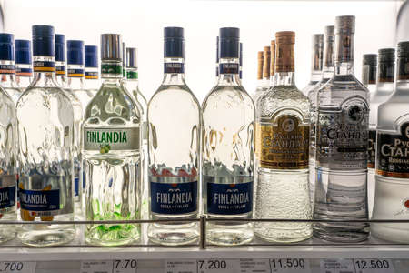 Muscat, Oman - january 19, 2020: Bottles of vodka Finlandia and vodka Russian Standard on a shelf in duty free shop airport in Muscat, Oman