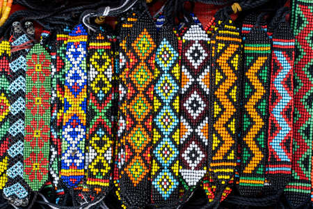 Tribal colorful beads bracelets for sale for tourists at the street market in Kota Kinabalu, island Borneo, Malaysia, close up