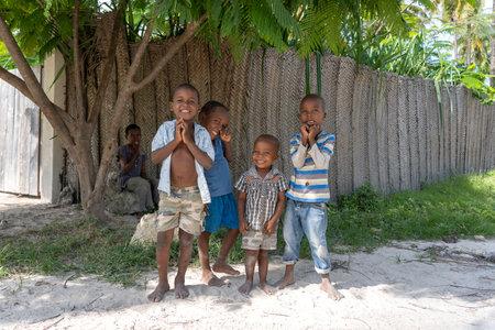 Zanzibar, Tanzania - january 04, 2020: Unknown african young happy boys on a street of Zanzibar island, Tanzania, East Africa, close up Editorial