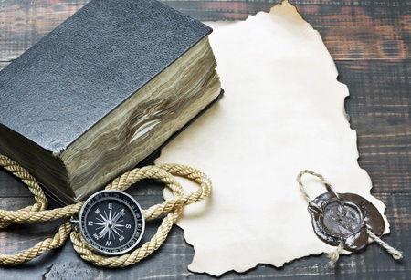 the scriptures: compass and an old book among other marine items