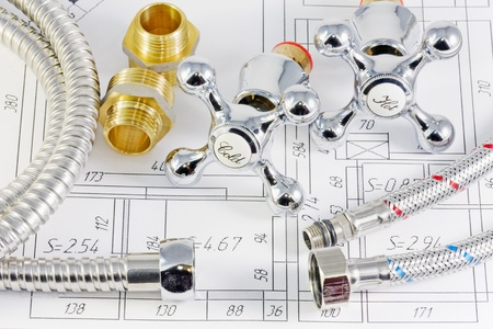 plumbing valves and hoses on the plan of the premises Stock Photo - 10798680