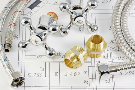 plumbing accessories: different plumbing and metal accessories on the layout of apartments   Stock Photo