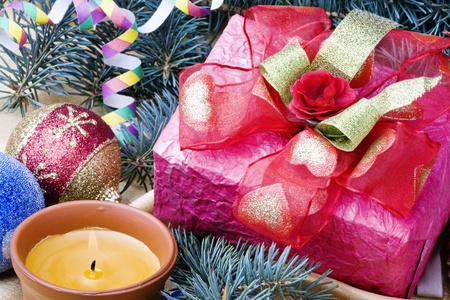 bright present and other Christmas decorations Stock Photo - 10889161