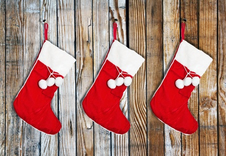 stocking: Christmas socks hung on a wooden wall