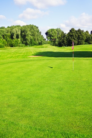 green golf course with sand pits photo