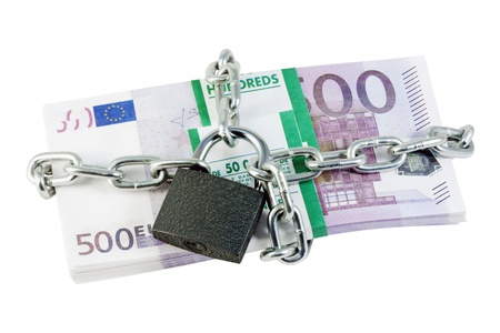 euro banknotes tied with a chain and closed at the castle Stock Photo - 10924263