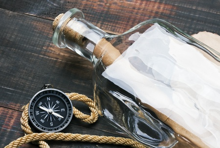 compass, a rope and a message in a bottle photo