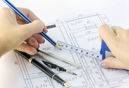 arms measure and draw a plan of the premises Stock Photo - 10962791