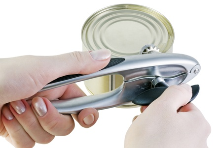 hand opens a jar of canned food isolated on white photo