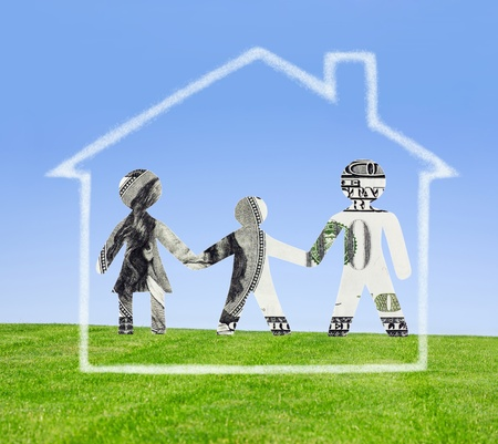 Family cut out from a dollar denomination and the house from clouds