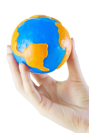 Globe of clay in the hand isolated on white background photo