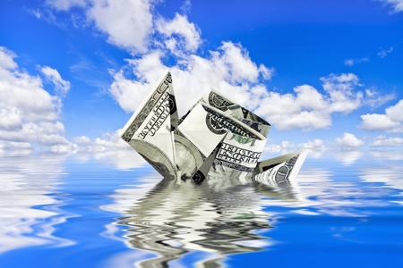 sinking ship of the dollar against the blue sky photo