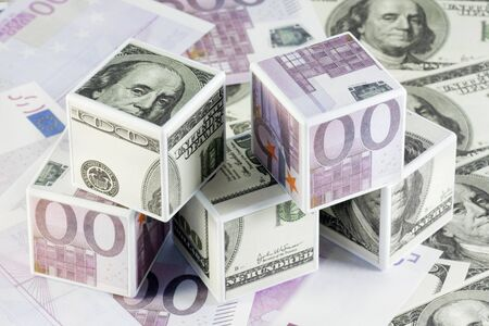 cubes pasted over with dollars and euros photo