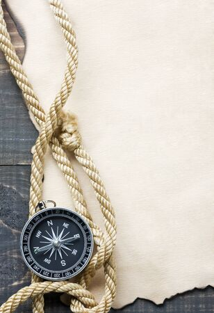 rope background: Compass on vintage paper background Stock Photo