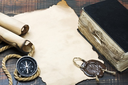 The Bible and compass on old paper photo
