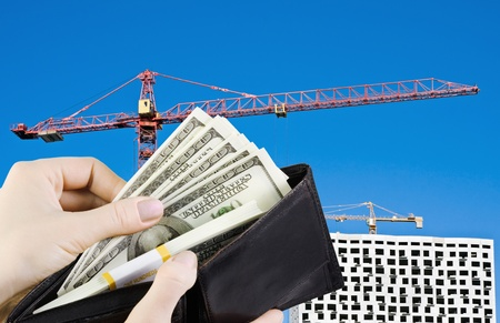 purse full of money to buy a new home Stock Photo - 11272245