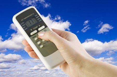 remote from the conditioner in the womens arm against the sky