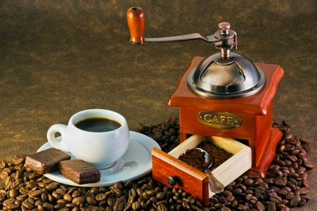 coffee grinders to coffee beans and coffee cup cooked photo