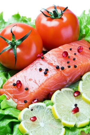 red fish and fresh vegetables on a white background Stock Photo - 11484076