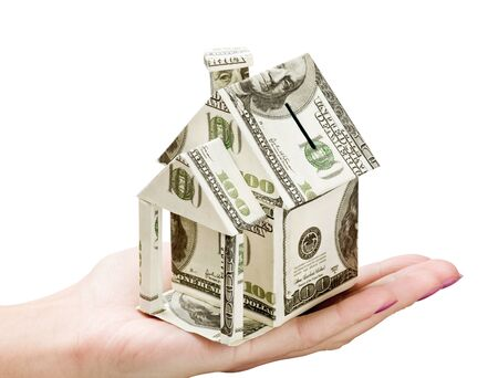 hand holds a house made from dollars Stock Photo - 11484056