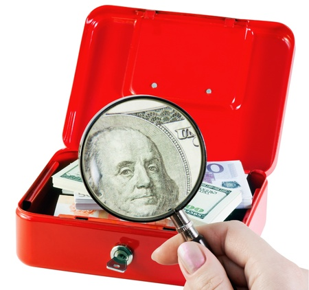 examines and counts the money in a moneybox Stock Photo - 11484057