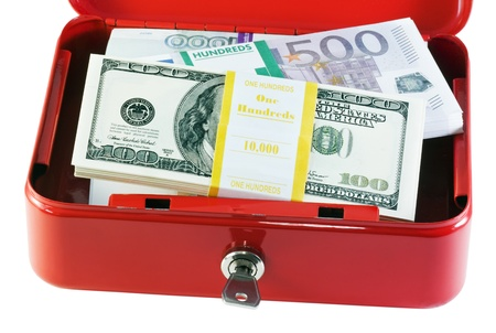 red metal box with different currencies is isolated on white Stock Photo - 11484301