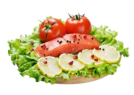 red fish and fresh vegetables on a white background Stock Photo - 11485064